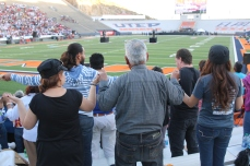 Catholics inside the Sun Bowl Stadium for the Pope's mass in Mexico holds hands to pray. February 2016.